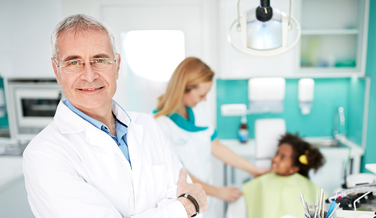 dentist in practice with patients